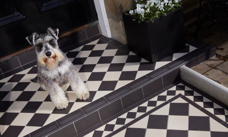 Dorchester Black & Dover White Footpath Tiles With Schnauzer Sat On Step