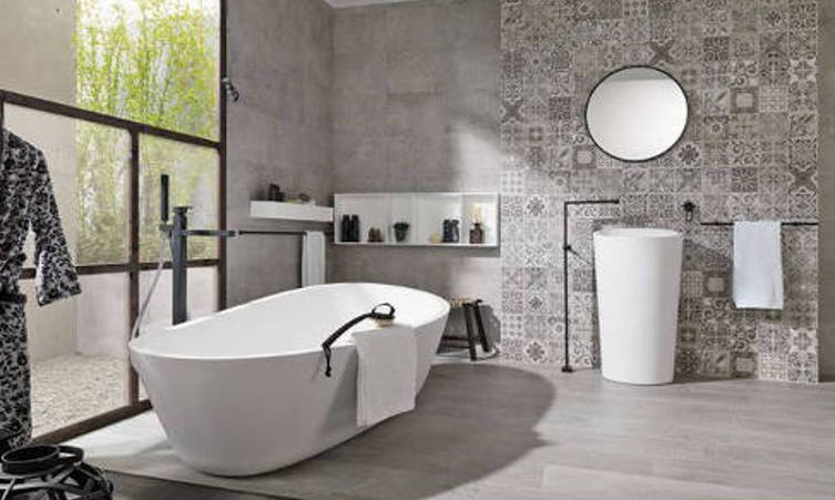 Porcelanosa Grey plain and patterned wall and floor tiles in a bathroom