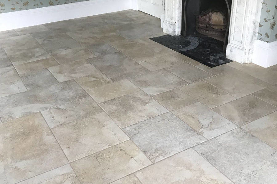 Porcelain Floor Tiles In Room With Decorative Marble Fireplace