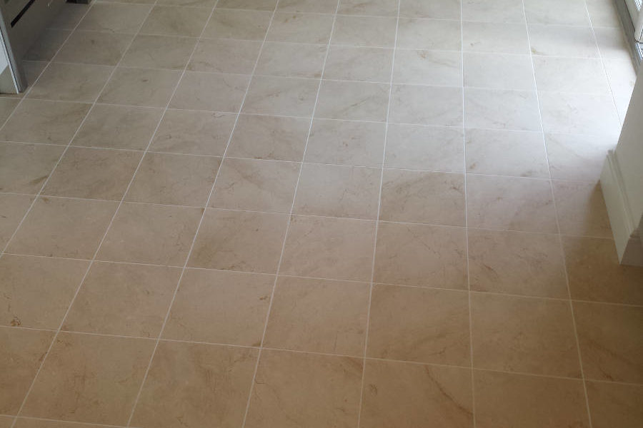 Small Square Beige Stone Tiles In Kitchen