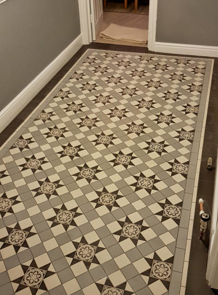 Geometric Grey Victorian Tiles In Hallway