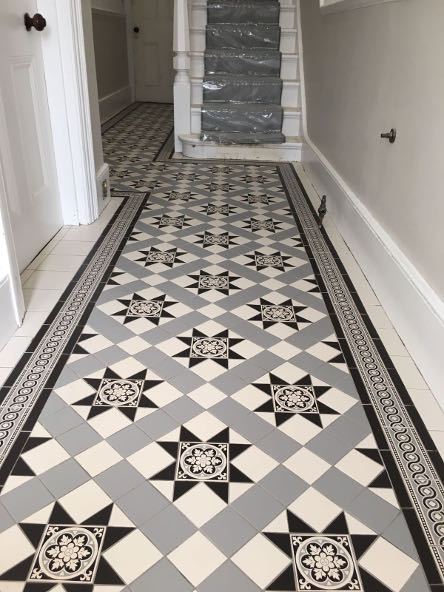 Black White And Grey Victorian Pattern Floor Tiles In Corridor