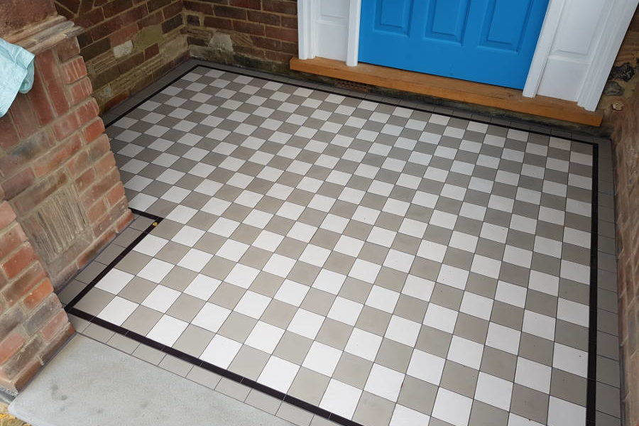 Brown And White Square Victorian Tiles In Porch Area